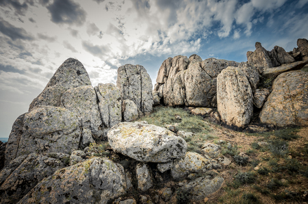 rock formation: Rocks formations in Dobrogea, Tulcea county, Romania. Naturally formed piles of large rocks in Macin Mountain the olders alps in Europe Stock Photo