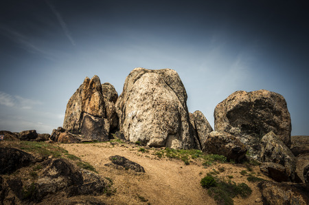 Rocks formations in Dobrogea, Tulcea county, Romania. Naturally formed piles of large rocks in Macin Mountain the olders alps in Europe Stock Photo
