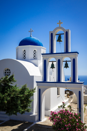Greek Church on Santorini island, Greece. Small white and blue church in Cyclades