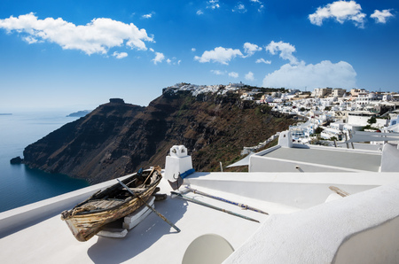 dome of the rock: Fira, Thira town, Santorini, Cyclades islands, Greece. Beautiful view of the town with white buildings, blue churchs roofs and many colored flowers.
