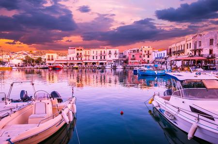 RETHYMNO, CRETE ISLAND, GREECE – JUNE 29, 2016: Stunning sunset over the old venetian port of Rethimnon on Crete island, Greece. Editoriali