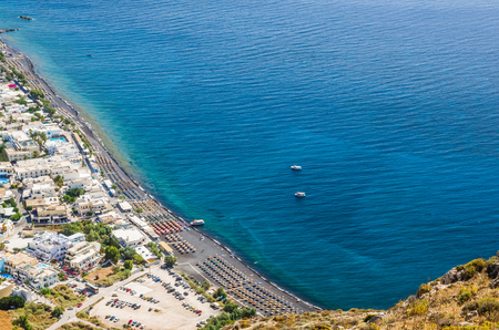 Kamari beach, Santorini island, Greece. Beautiful aerial view of Kamari village from Ancient Thira Stock Photo