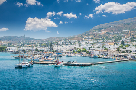 PAROS, GREECE - JUNE 29, 2017: Beautiful view of Parikia town in Cyclades Islands. There are white houses and boats in the old harbor.
