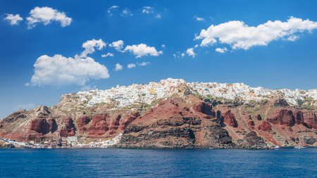 Santorini, Cyclades Islands, Greece. View from the see of Oia village and Amoudi harbour in Thira island