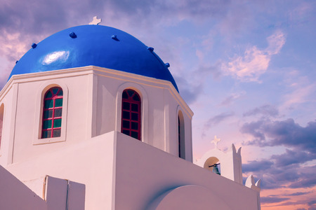 Oia Village, Santorini Cyclade islands, Greece. Beautiful view of a blue dome church Reklamní fotografie