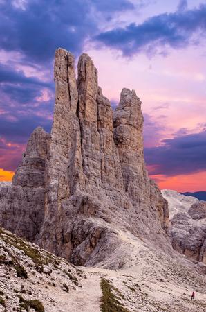 Sunset over Torri di Vajolet in Rosengarten Catinaccio massif. Beautiful view in Dolomites mountains, Alto Adige, South Tyrol, Italy Фото со стока
