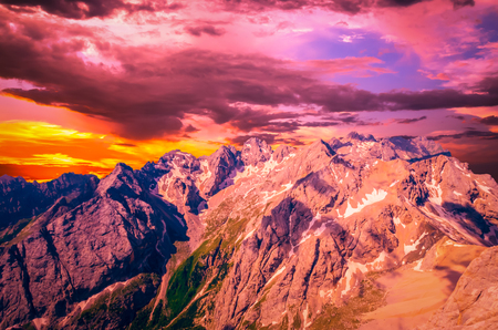 Stunning sunset over Marmolada massif, Dolomiti, Itay. Spectacular view over the Punta Rocca and other peaks in Dolomites mountains