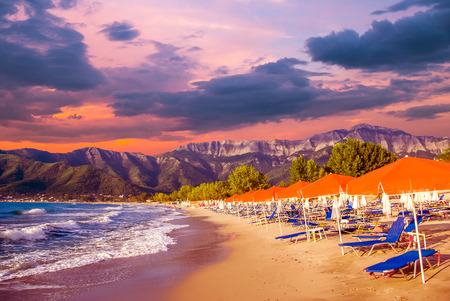 Stunning sunset at Psili Ammos beach, Thassos island, Greece. It is known as Golden beach. It is situated between Skala Panagia and Skala Potamia. Reklamní fotografie - 126304322