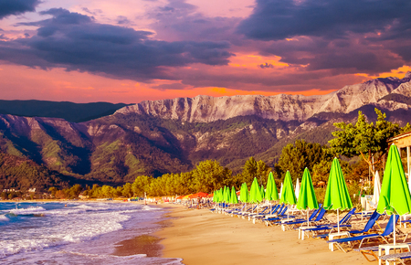 Stunning sunset at Psili Ammos beach, Thassos island, Greece. It is known as Golden beach. It is situated between Skala Panagia and Skala Potamia. Reklamní fotografie - 126304323