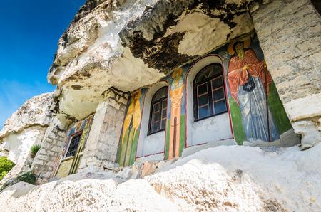 Basarabov Rock Monastery, Bulgaria. Basarbovo, the Monastery of Saint Dimitar Basarbowski is a Bulgarian orthodox cave monastery near city of Ruse Reklamní fotografie - 126304412
