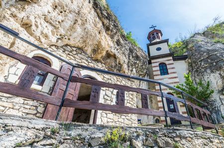 Basarabov Rock Monastery, Bulgaria. Basarbovo, the Monastery of Saint Dimitar Basarbowski is a Bulgarian orthodox cave monastery near city of Ruse Фото со стока