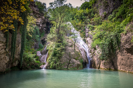 Kaya Bunar Waterfall, Bulgaria. It is located in Hotnitsa Canyon on Bohot river Reklamní fotografie - 126304415