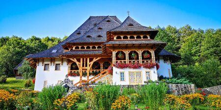 Unidentified tourists visiting Barsana monastery on August 16, 2019. Maramures area, Romania Zdjęcie Seryjne - 138479543
