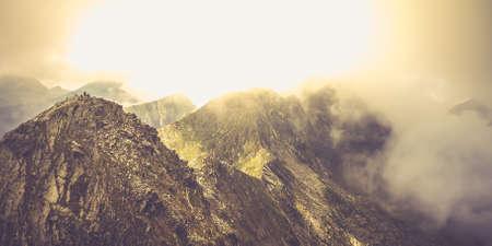 Misty Fagaras Mountains, Romania. Mist over the alps of Transylvania. Фото со стока