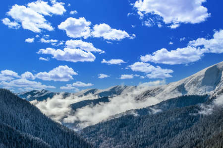 Stunning view of Fagaras mountains in winter. The ridge of the mountain full of snow. There are one of the beautiful road in the world, Transfagarasan