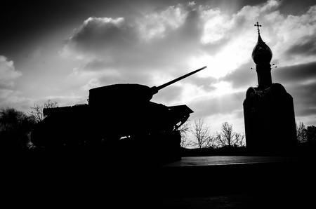slaves: Tank and church silhouette in Tiraspol, Transnistria