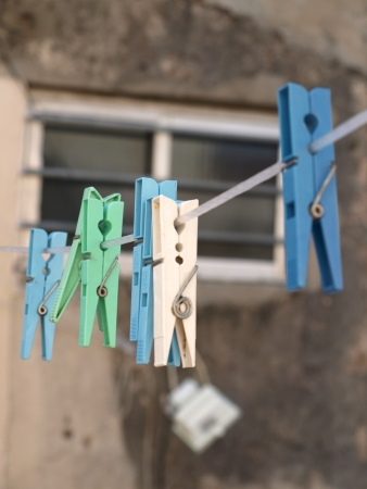clothes pegs hanging on clothesline Stock Photo - 16189198