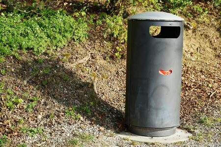 a metal garbage bin on a hiking trail with supply of plastic bag for dog droppings. Stock fotó - 146020912