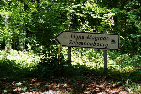 A direction shield pointing to Maginot line and its fortification Schoenenbourg in Eastern France on the Border with Germany. The shield is directing the visitors and tourists who come for sightseeing