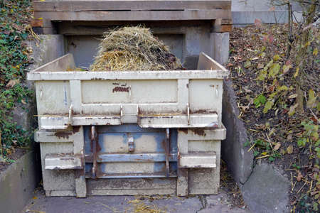 Container full of animal manure collected in a zoo. It shows the care for a healthy environment and well being of animals, to keep them healthy and in good condition.