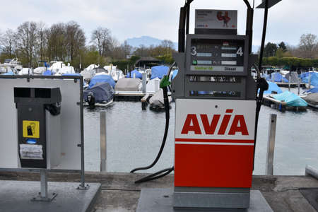 Lucerne, Switzerland 04 17 2021:  Front view on fuel filling station from Avia company in marina harbor of city of Lucerne situated on Lake Lucerne with moored yachts and motor boats in background.
