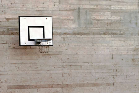 Cement wall with a basketball hoop with a lot of copy space. Banque d'images