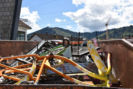 Scap iron in a big metal container in scrap collecting yard in Einsiedeln, Switzerland.