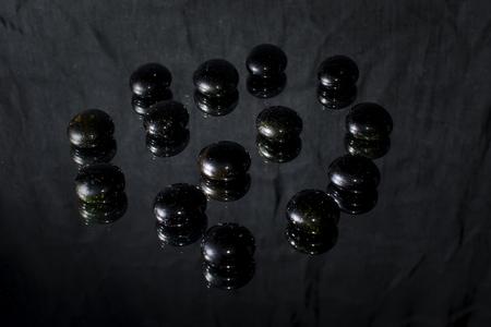 black pebbles: Black pebbles isolated on black background