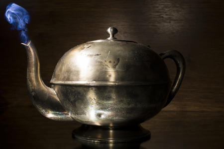 house ware: Old kettle isolated on  black background Stock Photo