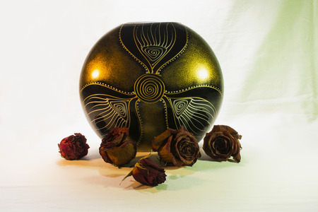 showpiece: Ceramic flower pot  and dry roses