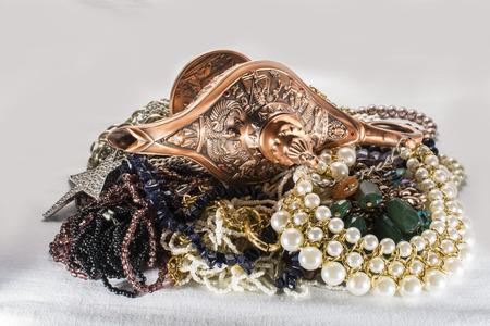 three wishes: Aladdins lamp and jewels Stock Photo