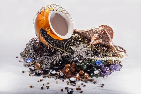genie in a bottle: Aladdins lamp , ceramic pot and jewels