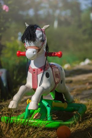 rocking: Rocking horse on garden background