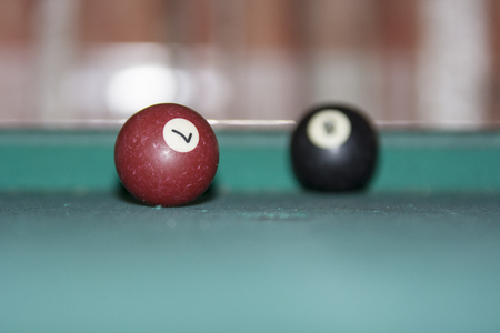 top 7: Pool balls isolated on pool on table Stock Photo