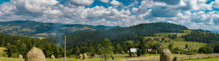 Panoramic view over Carpathian Mountains , Romania in a  beautiful summer day Stock Photo