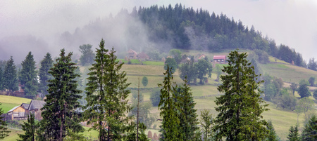 distinctive: Moist spreading over Arieseni village in Romania, Apuseni Mountains