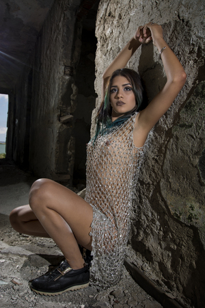 Young girl posing in a silver fishnet dress Stok Fotoğraf