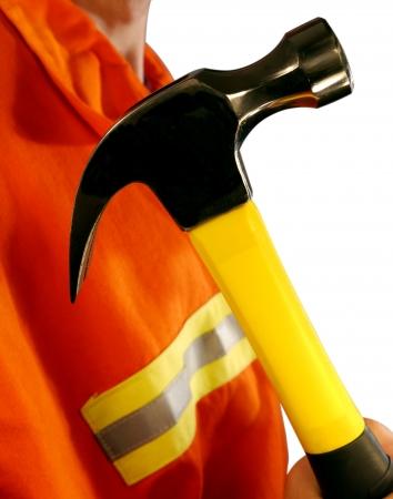 Construction Worker Holding Hammer Wearing High Visibilibilty Jacket