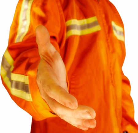 safety vest: Construction worker offering hand shake Stock Photo
