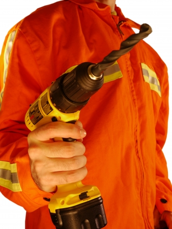 Construction Worker Holding Drill Wearing High Visibilibilty Jacket