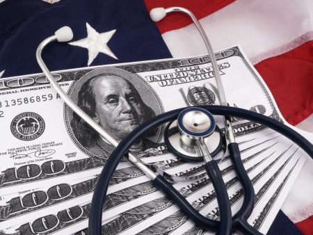 doctor money: Government Concept  Government Medical Costs With 100 Dollar Bills And Stethoscope Over American Flag