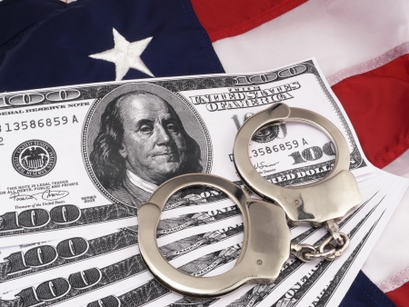 cuffs: Government Concept  Government Police Costs With 100 Dollar Bills And Hand Cuffs Over American Flag