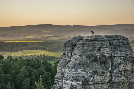 climber standing on the top of a sandstone hill Stockfoto