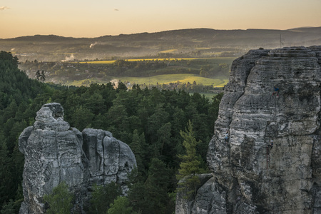 evening landscape at sunset in Czech paradise, sandstone rocks, landscape enlightened by the setting sun