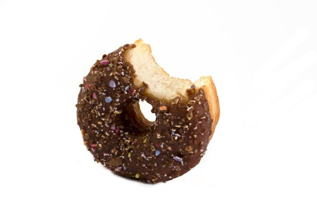 chocolate covered doughnut with a bite taken out over white Stock Photo - 6906849