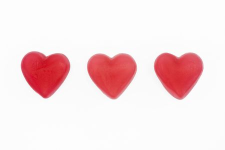 red and white love heart sweets on a white background Stock Photo