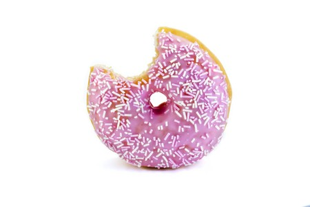 strawberry flavoured doughnut witha bite taken out isolated on white Stock Photo - 6906948