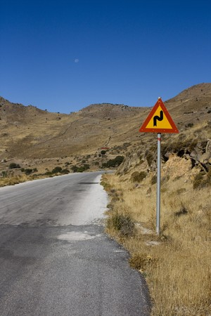 road sign on a deserted road photo