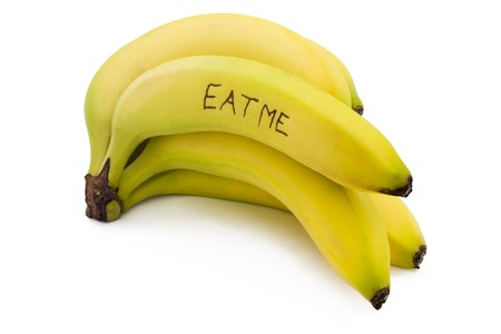 eat me bunch of bananas on a white background Stock Photo