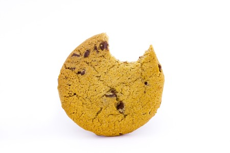 chocolate chip cookie with a bite taken on white
